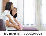 asian little girl giving her... | Shutterstock . vector #1090290905