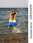young happy man  throwing water ... | Shutterstock . vector #109029659