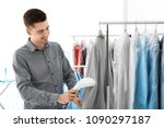 young man steaming jacket at...   Shutterstock . vector #1090297187