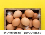 eggs in a wooden box  top view... | Shutterstock . vector #1090298669
