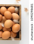 eggs in a wooden box  top view... | Shutterstock . vector #1090298681