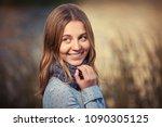 happy young girl walking... | Shutterstock . vector #1090305125
