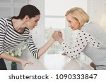 family battle. nice young woman ... | Shutterstock . vector #1090333847