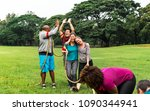 team competing in tug of war | Shutterstock . vector #1090344941