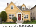 Yellow Single Family Home With...