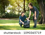 young volunteer picking up... | Shutterstock . vector #1090365719