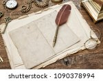 vintage used paper with feather ... | Shutterstock . vector #1090378994