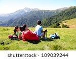 family laying down the grass... | Shutterstock . vector #109039244
