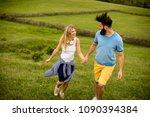 lovinh couple enjoying a walk... | Shutterstock . vector #1090394384