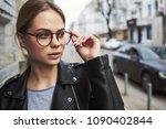 beautiful woman strolls down... | Shutterstock . vector #1090402844