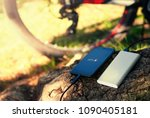 a portable charger charges the... | Shutterstock . vector #1090405181