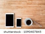 smartphone and tablet on wooden ... | Shutterstock . vector #1090407845