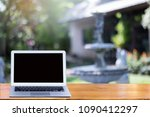 blank screen modern laptop on... | Shutterstock . vector #1090412297