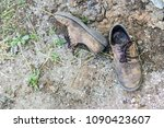 pair of old dirty used shoes. ...   Shutterstock . vector #1090423607