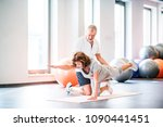 senior physiotherapist working... | Shutterstock . vector #1090441451