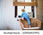 toddler boy in a dangerous... | Shutterstock . vector #1090441991