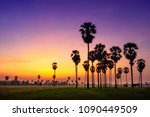 silhouette palmyra palm with... | Shutterstock . vector #1090449509