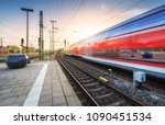 red high speed train in motion... | Shutterstock . vector #1090451534
