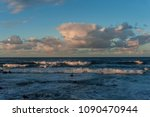 rolling cloudscape over... | Shutterstock . vector #1090470944