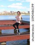 a slender blonde in a spring...   Shutterstock . vector #1090486199