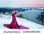 girl in a winter dress on rocks | Shutterstock . vector #1090498394