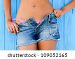 Close up of a woman in jeans texas shorts - stock photo