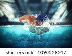 athlete swims in a blue deep... | Shutterstock . vector #1090528247