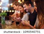 group of friends enjoying meal... | Shutterstock . vector #1090540751