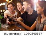 group of friends enjoying meal... | Shutterstock . vector #1090540997