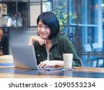 happy young asian woman working ... | Shutterstock . vector #1090553234