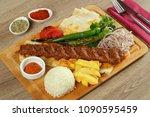 turkish adana kebab on the wood ... | Shutterstock . vector #1090595459