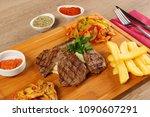 delicious beef steak meat on... | Shutterstock . vector #1090607291