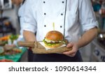 master chef putting toothpick... | Shutterstock . vector #1090614344