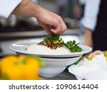 chef hands serving spaghetti on ... | Shutterstock . vector #1090614404