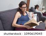 beautiful woman relaxing on... | Shutterstock . vector #1090619045