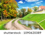 pond with an autumn forest and... | Shutterstock . vector #1090620389