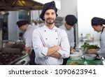 portrait of young chef standing ... | Shutterstock . vector #1090623941