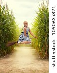 the girl is on the broom.... | Shutterstock . vector #1090635821