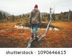 man wanderer standing alone in... | Shutterstock . vector #1090646615