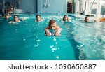 male trainer swims with female... | Shutterstock . vector #1090650887