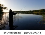 silhouette of fisherman... | Shutterstock . vector #1090669145