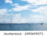 white yacht on sea ocean under... | Shutterstock . vector #1090695071