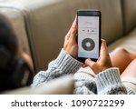 woman listening to music...   Shutterstock . vector #1090722299