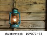 Rusty Lit Blue Lantern Hanging...