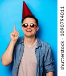 young man in birthday hat and... | Shutterstock . vector #1090794011