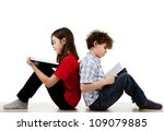 Girl And Boy Reading Books On...