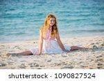 teenager girl doing split on... | Shutterstock . vector #1090827524
