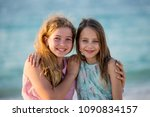 two teenagers girls  on the... | Shutterstock . vector #1090834157