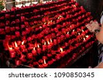 pray front of red candle ...   Shutterstock . vector #1090850345