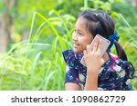 little girl using smartphone to ... | Shutterstock . vector #1090862729